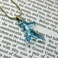 Swarovski blue coral pendant on a sterling silver snake chain.