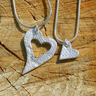Two fine silver patterned heart pendants on sterling silver snake chains