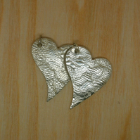 Two fine silver heart pendants