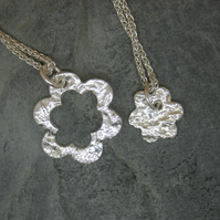 Mummy and Me. Two fine silver patterned flower pendants