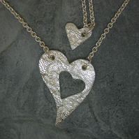 Mummy and Me. Two fine silver patterned heart pendants