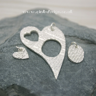 Mummy and Me. Three fine silver patterned pendants