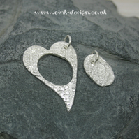 Mummy and Me. Two fine silver patterned pendants