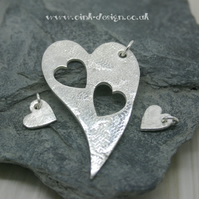 Mummy and Me. Three fine silver patterned heart pendants
