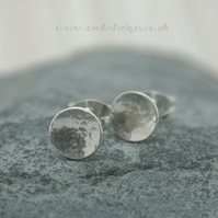 Sterling silver circle stud earrings with delicate hammered texture