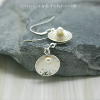 Sterling silver drop earrings, hammered finish, domed with a swarovski pearl