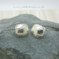 Sterling silver square stud earrings with a hammered finish and domed
