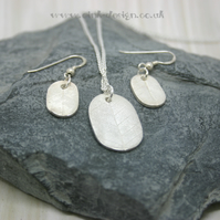 Fine silver necklace and earring set.