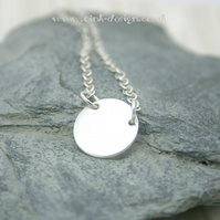 Understated sterling silver circle necklace