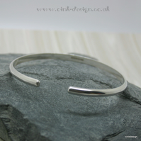 Small sterling silver D wire open bangle
