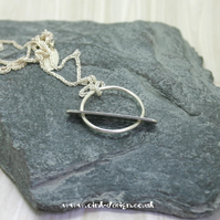 Sterling Silver circle with solid movable flat bar