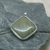 Nephrite gemstone pendant set in Sterling Silver spectacle setting