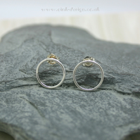 Small circular sterling silver stud earrings