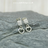 Sterling silver cube stud earrings with a hanging heart