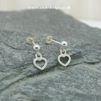 Sterling silver sphere stud earrings with a hanging heart