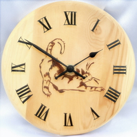 Wooden clock painted with a stretching cat