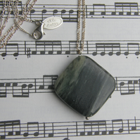 Green banded agate pendant on a figaro necklace