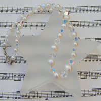 Swarovski clear AB crystal and ivory freshwater pearl necklace.