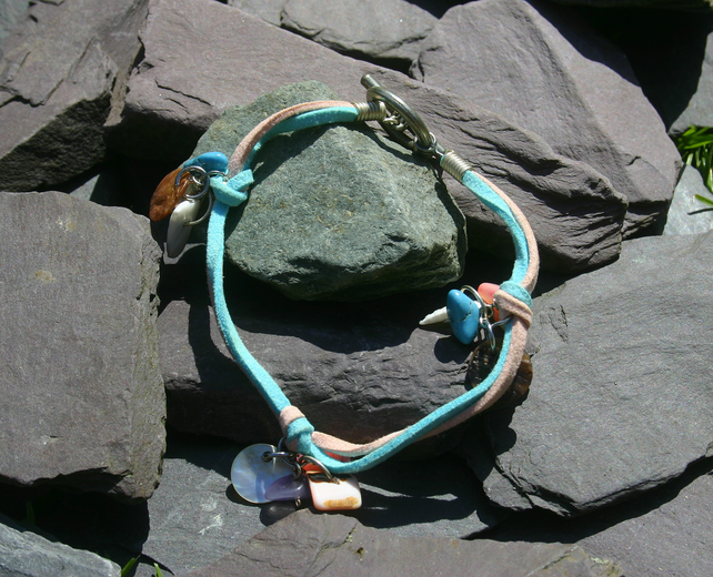 Light pink and turquoise suede anklet with toggle clasp and charms.