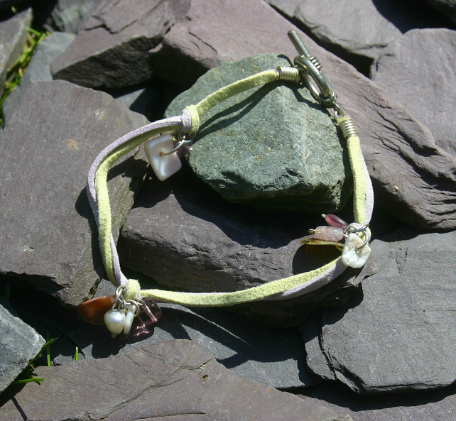 Light yellow green and lilac suede anklet with toggle clasp and charms.