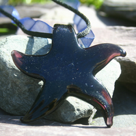 Sale 50% off. Glass star pendant strung on blue ribbon, black satin cord.