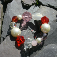 Sale item. 50% off pink, white and red beaded bracelet