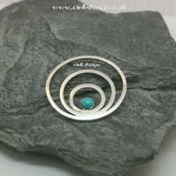 Sterling Silver circles with a Turquoise stone pendant