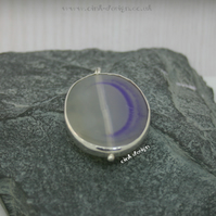 A slice of mauve agate set in sterling silver spectacle setting