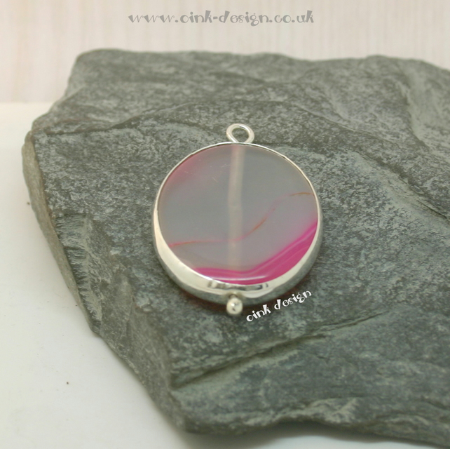A slice of transparent white with hot pink agate set in sterling silver