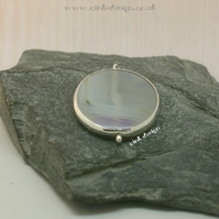 A simple piece of white and lilac agate set in sterling silver