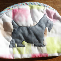 A matching set of bags with a Scottie dog design