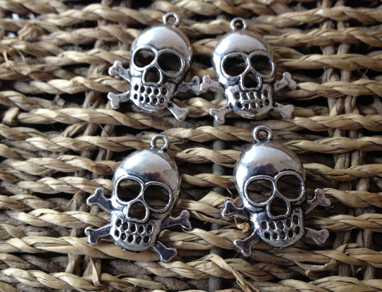 4,Skull and crossbones pendants or large charms 26x22mm