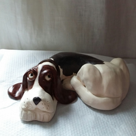 Clay Lounging Hound sculpture