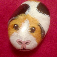 Guinea pig painted on stone