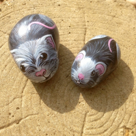 Two little mice painted on stones