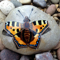 Butterfly hand painted on smooth stone
