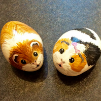 Two Guinea pigs painted pebble rock pets