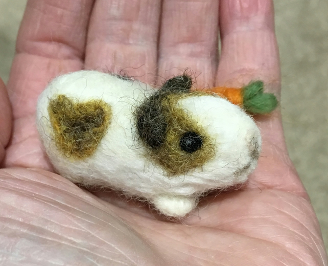 Guineapig miniature needlefelt pet with hearts and a carrot