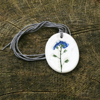 Forget me not Imprinted Oval Ceramic Pendant on Hemp Cord