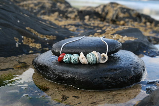 Turquoise Seashell Printed Ceramic Bead and Barnacle Necklace on Silver Chain