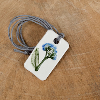 Forget me not Imprinted Ceramic Pendant on Hemp Cord