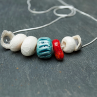 White, Red & Turquoise Ceramic Bead and Barnacle Necklace on Silver Chain