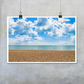 Calm Kent Sea in summertime print.  Blue calm water, white clouds golden shingle