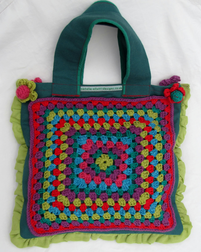 Fabric and crochet bag in greens and reds.