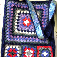 Crochet bag in blues and geranium red