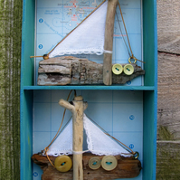 Two small driftwood boats