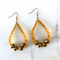 Amber and Bronze beaded tear drop earrings