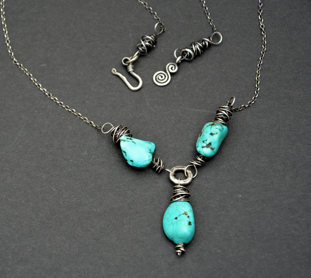 Necklace of sterling silver and turquoise chunks.