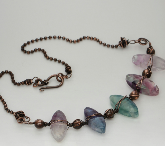 Fluorite and copper wire wrapped necklace.