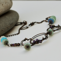 Copper necklace with faceted amazonite and amethyst.